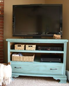 Garage sale dresser turned into a TV stand. I totally need to do this, as my TV sits on a cedar chest right now