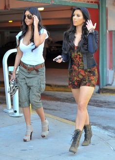 """Kim wore this fabulous """"Camo Romper"""" when she stepped out with her big sis in Miami. Brand: Magda Berliner"""