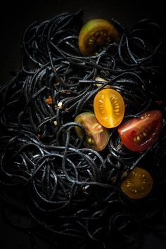 Squid ink pasta... It's so simple, so gorgeous and so delicious. I can't believe it took me this long to finally cook with it at home. Eating pasta never looked so fancy. ----- SQUID INK PASTA WITH GARLIC AND TOMATOES Print Recipe INGREDIENTS:...