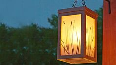 Capture leaves and grass on waxed paper to make natural-look shades for a simple lantern.