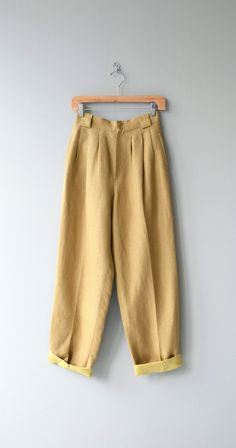 The perfect pair of 1980s Giorgio SantAngelo linen pants in dijon with high waist, wide belt loops, double button waist, pockets and lining. ✂-----Measurements  fits like: small waist: 26 hip: up to 44 length: 43 rise: 13 inseam: 30 brand/maker: Giorgio SantAngelo condition: excellent  to ensure a good fit, please read the sizing guide: http://www.etsy.com/shop/DearGolden/policy  ✩ visit the shop ✩ http://www.DearGolden.etsy.com  _____________________ ✩ www.deargolden.com ✩ twitter…