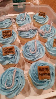 Fishing themed cupcakes with fondant toppers