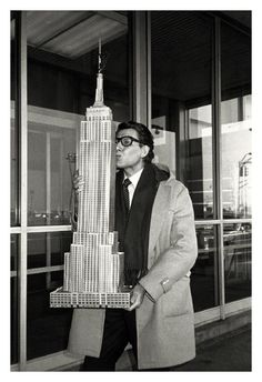 YSL embraces a model of the Empire State Building, 1983. Photo: Roxanne Lewitt.