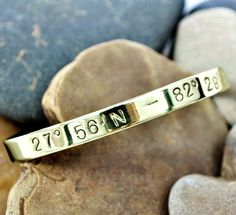 Bracelet stamped with the longitude and latitude of where you were born, where you're getting married or the place you met your best friend.