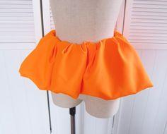 JIL SANDERランウェイ登場のペプラムベルトです。スカートでもパンツでも素敵です。 シンプルなワンピースやパンツにコーディネイトするだけでパーティー仕様にもなります。実物はとても発色のきれいなネオンのオレンジです。素材ポリエステル 100%イタリー製後ろのジップは全開はしません。中古ですがきれいなコンディションです。http://feithblog.blogspot.jp/2015/08/jil-sander_1...