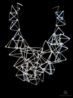 """Andreea Bololoi Jewelry: """"Interconnected"""" Necklace   #statement #necklace #geometric #volume #threedimensional #pyramid #triangle #silverplated #wire #wirework #handcrafted #handmade #contemporaryjewelry #ArtJewelry #andreeabololoijewelry Jewelry Art, Jewelry Necklaces, Three Dimensional, Silver Plate, Triangle, Wire, Handmade, Fashion Design, Hand Made"""