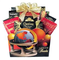"""""""A World of Thanks"""" Gift Basket containing assorted snacks and drinks. Available at Thoughtful Expressions Gift Baskets with Canada wide shipping."""