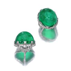 An emerald and diamond ring centering an oval emerald cabochon, measuring approximately 23.3 x 20.5 x 16.55mm., within a baguette and single-cut diamond surround; emerald weighs approximately: 22.00 carats; mounted in platinum; size 4 1/4 (with sizer)