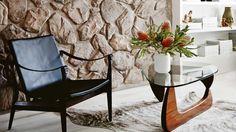 living-room-stone-wall-coffee-table-flowers-hide rug july15