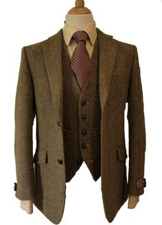 Iain Harris Tweed Jacket & Waistcoat This tailored Harris Tweed Iain Jacket has a exclusive luxury Harris tweed Orb design lining that compliments the pattern of the Harris Tweed, with slanted hip pockets, ticket pocket, elbow patches and genuine leather buttons, with a matching waistcoat. Or add a pair of matching Trousers to make an impressive 3 piece suit, trousers have 2 side pockets, one back pocket, zip fly and are lined to the knee, with belt loops, each item comes with the Offical Ha