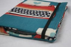 """There are lots of kindle-cover tutorials floating around, but what I really like about Deborah's (from Whipstitch) is that in addition to the four fabric corners used for viewing, there is also a secret full pocket to keep it more secure during travel. Also, I just love everything Deborah does (""""Hi Deb!"""")."""