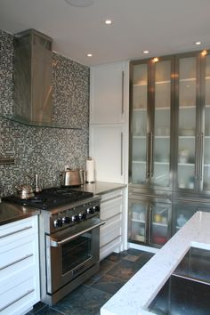 Stainless and frosted glass cupboard (Cultivate.com)