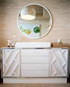Wall Treatment Photo - A round mirror and a white dresser against grass-cloth wallpaper