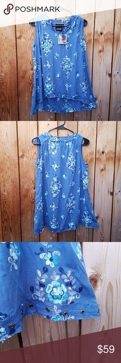 NWT Nanette Lepore Embroidered Blue Riveted Top Modern rivets/fraying along neckline and hem.  Gorgeous! Excellent condition  Feel free to ask me any additional questions! Bundles of 3+ items are 15% off. No trades, or modeling. Happy Poshing! Nanette Lepore Tops