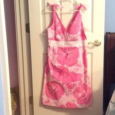 Lilly Pullitzer sundress Pink with flowers, lace detailing around midsection, and ties at each shoulder. Size 8, fits well very flattering on. Worn one time to high school graduation. Lilly Pulitzer Dresses