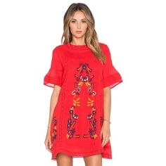 Free People Perfectly Victorian Dress Size: XS. Color: Tomato. Effortless and shapeless Victorian inspired mini dress featuring a beautiful floral embroidery and crochet trim. Pleat detailing along the high neck. Button closure in back with a keyhole opening. Lined. Free People Dresses