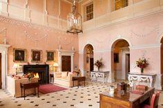 Kelmarsh HallinNorthamptonshire,England.The hall still retains the pink terracotta decoration by Nancy Lancaster.