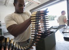 11/6/2013 - U.S. Air Force Staff Sgt. Will Brown, 23d Equipment Maintenance Squadron conventional maintenance crew chief, inspects 50-caliber rounds at Moody Air Force Base, Ga., Oct. 31, 2013. The inspection ensures the rounds are functional and have no dents, cracks or punctures. (U.S. Air Force photo by Airman 1st Class Sandra Marrero/Released)