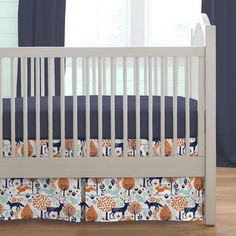 Carousel Designs Navy and Orange Woodland Crib Bedding Set: Our set in the Navy and Orange Woodland Crib Bedding collection includes a Solid Navy Crib Sheet, and a Navy and Orange Woodland Animals Crib Skirt Box Pleat Length.