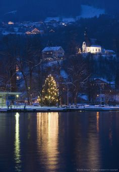 Austria, Salzkammergut, Mondsee, View of hilfbergkirche church with christmas tree by lake Less By Westend61 Westend61