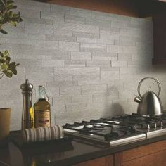 "A gray mosaic through-body porcelain tile backsplash--easy to clean up--from Marazzi. These are 12"" by 24"" mosaic tile sheets for quick installation."