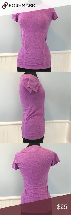 """Athleta Active Workout Shirt XS Athleta Active Workout Shirt - bottom of shirt has plastic grip to keep the shirt from riding up - 50% polyester, 45% nylon, 5% spandex - About 25"""" long, bust is about 14"""" (lying flat) - Tags: yoga top, workout shirt, Athleta shirt, running shirt, exercise shirt Athleta Tops"""