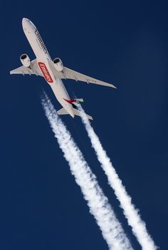 Love this airplane - an Emirates Boeing 777-300ER dropping contrails