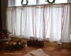 Ikea Dishtowel Hack.  Pretty cafe curtains for the kitchen made with my favorite frugal Ikea dishtowels for under $5.00! - redcottagechronicles.com