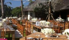 Natural wooden tiffany chairs throughout.