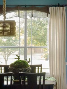 Lindsay from Makely School for Girls customized her windows by creating a scalloped valance out of 99-cent bamboo placemats. She transformed them with spray paint, a hot glue gun and some black ribbon.
