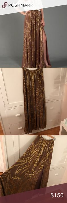"Rachel Zoe ""Vanessa"" maxi skirt. Brand new an absolutely gorgeous. 100% silk crinkle chiffon with metallic threads. Fully lined and has a slit. The skirt is very long. Meant to have it hemmed but never got around to it. I'm 5'6"" Rachel Zoe Skirts Maxi"