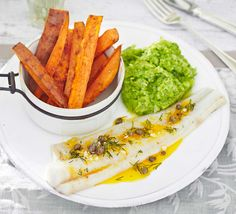 Fish and chips get a healthy makeover with a zesty caper dressing and minty mushy peas - replace with aubergine for a veggie option