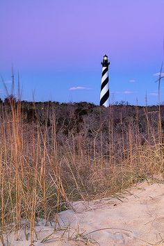 Dawn at Cape Hatteras Lighthouse, NC.this one has always been on my list Nc Lighthouses, North Carolina Lighthouses, Great Vacation Spots, Vacation Places, Scenic Photography, Night Photography, Landscape Photography, Cape Hatteras Lighthouse, Carolina Beach