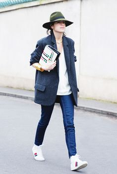 Leandra Medine @Man Repeller inspires in this feminine meets masculine look, wearing a wide-brimmed fedora, a simple white tee, an oversized blazer, indigo jeans, Saint Laurent sneakers, and an embellished clutch.