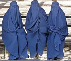 Three women, completely covered (Afghanistan?)  http://www.zarinas.com/