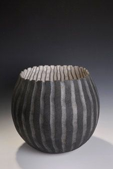 David Roberts: coil built, burnished slips and raku fired.