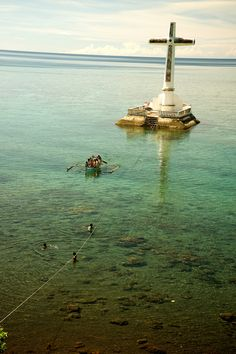 Sunken cemetery at Bobon, Camiguin, Northern Mindanao, Philippines - This cross replaces the original which fell into the sea. It marks the site of a graveyard that was submerged after the eruption of the nearby volcano.