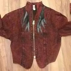 Acid wash ,deep burgundy, leather accents Should hit your waist excellent condition