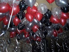Great choice of colours by our client here - Black and Red balloons, with a splash of star prints in White, Silver and Diamond clear all with metallic ribbon. We love this look!