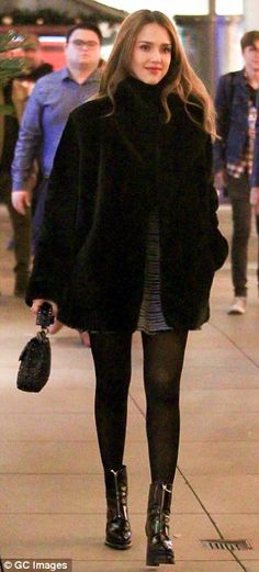 Winter warmer: The mother-of-two looked pretty as a picture as she strolled through Los An...