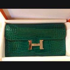 Hermes Constance wallet in shiney Niloticus crocodile, color Vert Fonce, in GHW.....