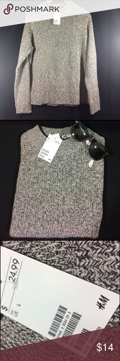 Grey H&M cable knit gray and black sweater NWT Adorable black and grey cable knit sweater from H&M - NWT and size L. Measurements are as follows : chest : 22' ; length : 22 '; H&M Sweaters Cowl & Turtlenecks