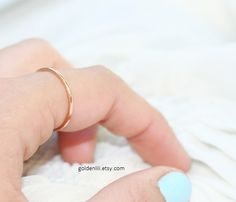 There is just something extra girly about a petite little ring on the index finger. Love.