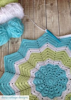 Turquoise and Lime Crochet Star Blanket by Daisy Cottage Designs - broken link, but same/similar pattern at file:///C:/Users/Heather/Dropbox/Personal/Knit%20&%20Crochet%20Patterns/CrochetDad_9_Pointed_Star_Round_Rippleva.pdf
