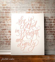 This hand-lettered Proverbs 31:25 design is printed onto thick museum quality canvas and stretched on a 16x20, 0.75 thick kiln dried pine frame.