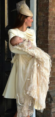 Catherine, Duchess of Cambridge carries her son Prince George Of Cambridge after his christening  on 23.10.13