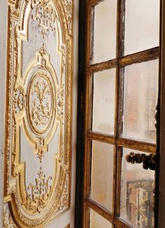 white boserie with golden details at a Versailles window