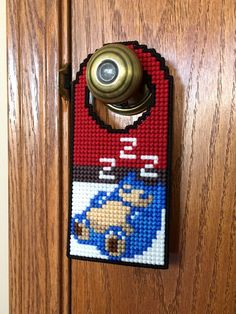Geek up any home or office by leaving a message any Pokemon Trainer would understand. Capable of fitting over most door knobs, these cross stitched door hangers feature a sleepy Pokemon as a reminder you wish to remain undisturbed. Pokemon Decor, Pokemon Room, Pokemon Snorlax, Pokemon Gifts, Nintendo Pokemon, Pokemon Merchandise, Anime Crafts, Diy Furniture Decor, Otaku Room