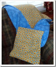 Quillow - quilt, folds up into a pillow, (tutorial here: http://www.quiltbug.com/Articles/quillow.htm)