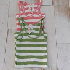 Hollister tanks Pink is XS green is a S some stain on green should come out in wash see photo Hollister Tops Tank Tops